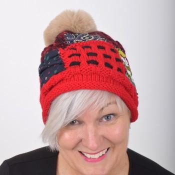 Warm hat with pompom