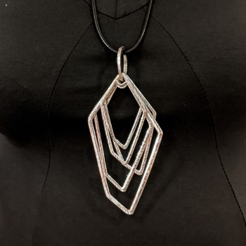 Long necklace with graphic pendant